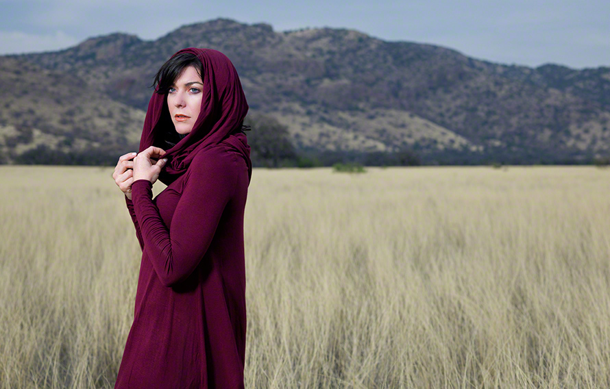 fine art photograph of female draped in maroon