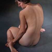 nude woman on gray background