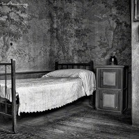 black and white photo of vintage single bed