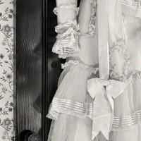 Party dress hanging on door