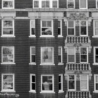 apartment building with scenes in windows