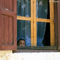 Madagascar child in window