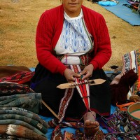 female weaver in market in Peru