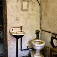 photograph of toilet and sink in prison cell