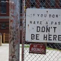 fence sign in prison compound