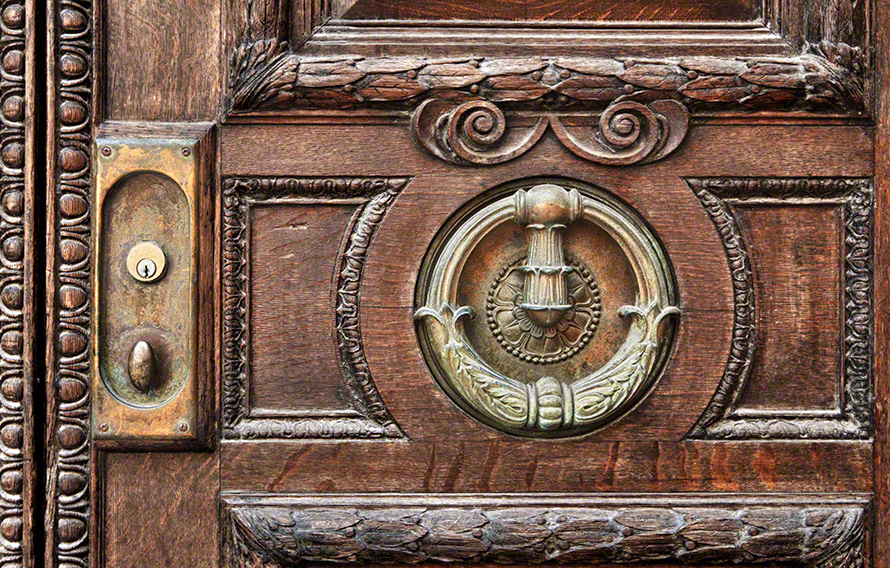 Close up of architectural detail on door.