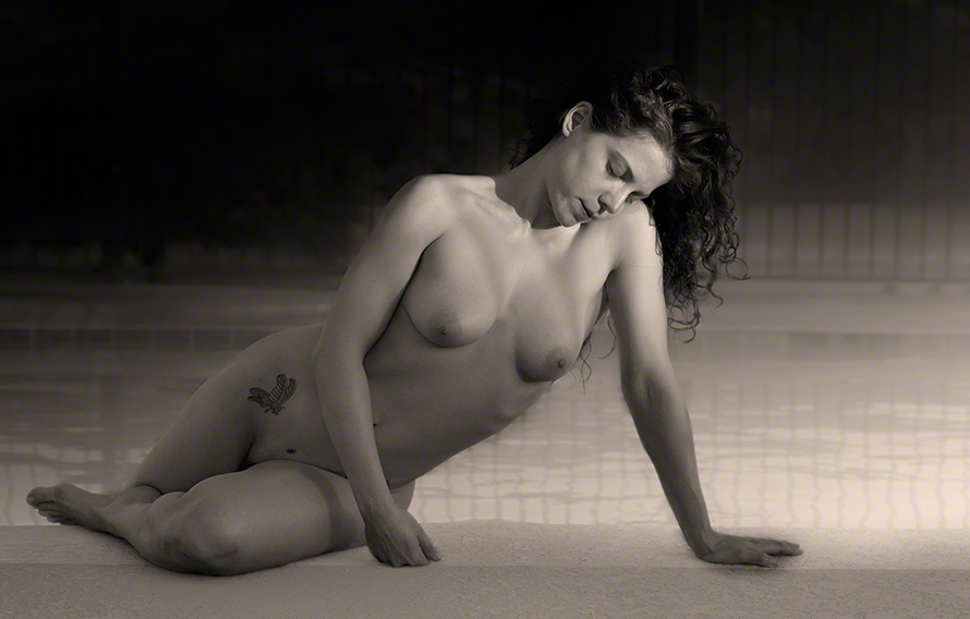 Female nude by pool.