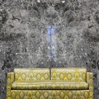photo art print of yellow couch in marble setting