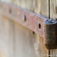 wood door and hinge macro photo