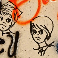 graffiti drawing of two female faces