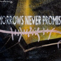 graffiti text on black and gold photograph