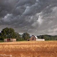 midwest farmland with barn and painting