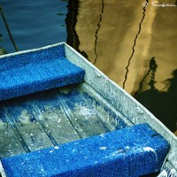 rowboat in water with reflections art photo