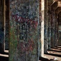 graffiti drawings under viaduct