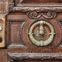 wood door detail with brass knocker