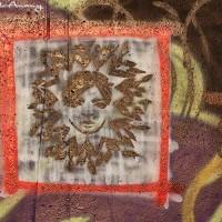 face on wall graffiti photo