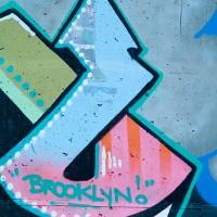 graffiti shapes and symbol on wall photo