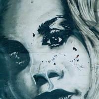 female face graffiti photograph