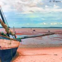 fishing boat on madagascar shoreline